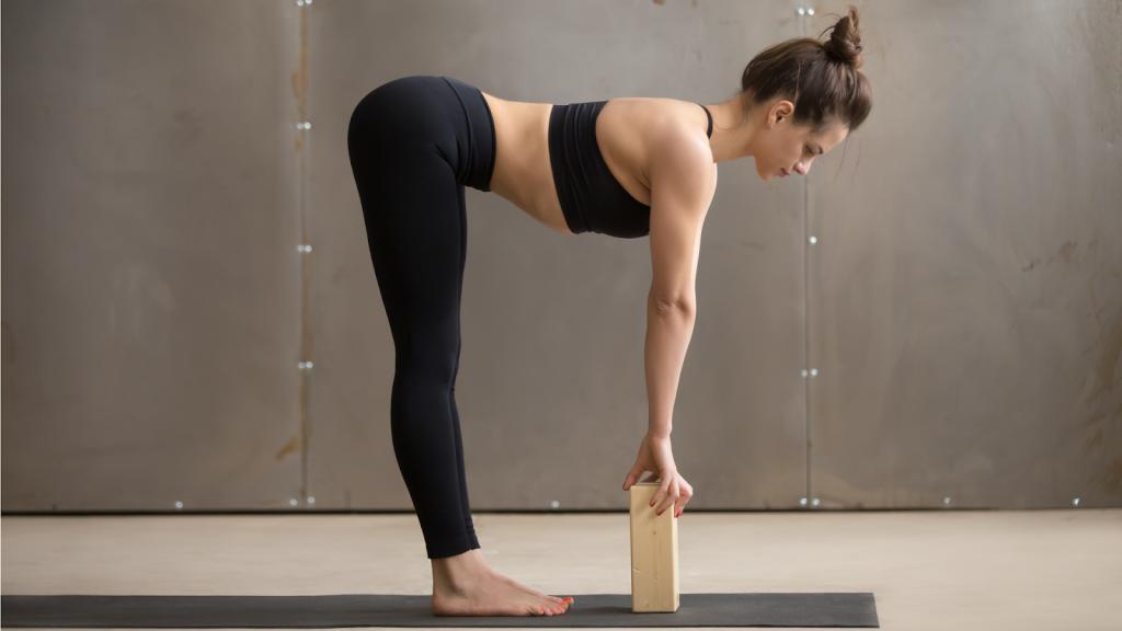 Half standing forward bend with blocks