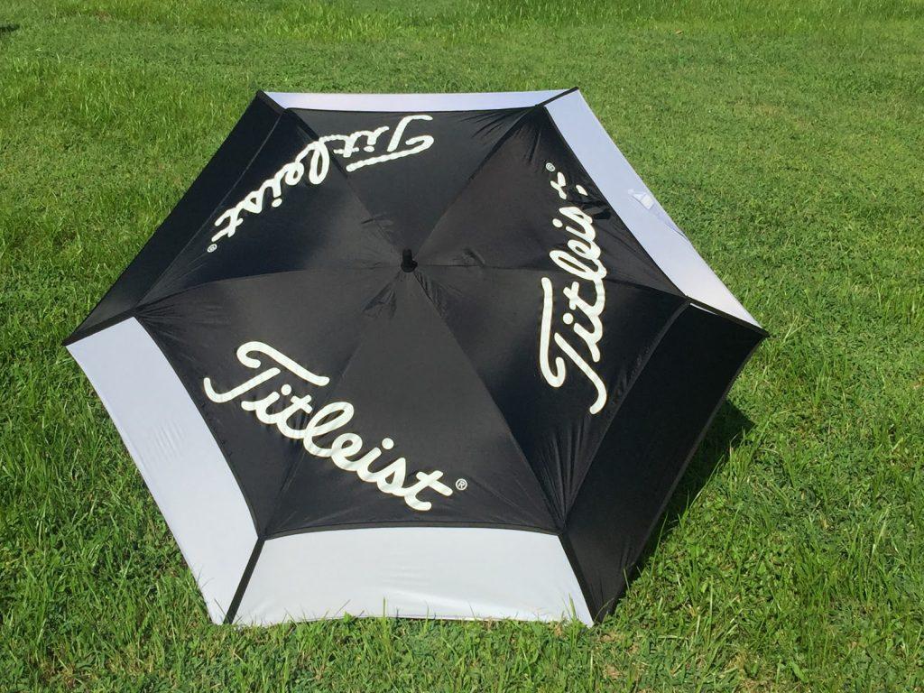 The Titleist Tour Double Canopy umbrella open.
