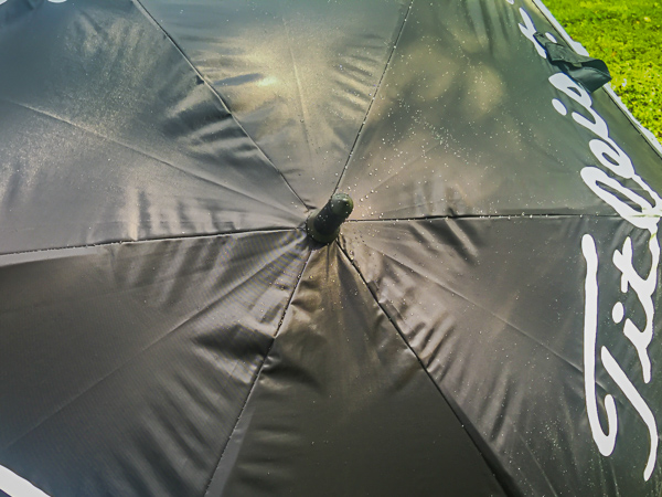After a 2 minute garden hose shower the water sat on top of the fabric of the Titleist Tour Double Canopy umbrella.