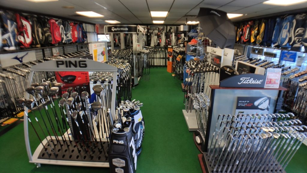 Howard's Golf Clubs Showroom of iron sets, drivers, woods, and wedges
